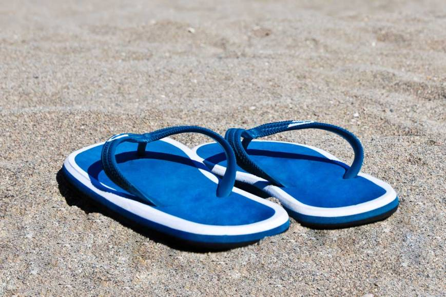 a pair of beach sandals on the sand